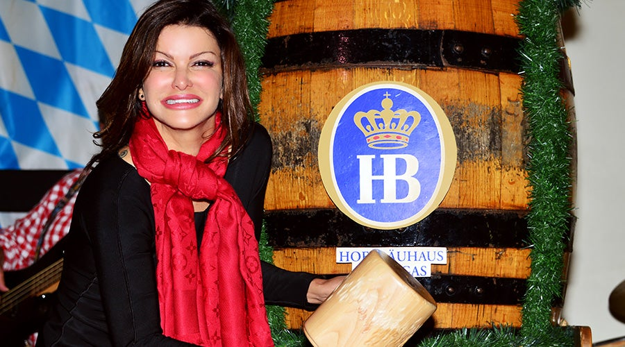 Celebrity chef Carla Pellegrino taps the keg at hofbrauhaus las vegas