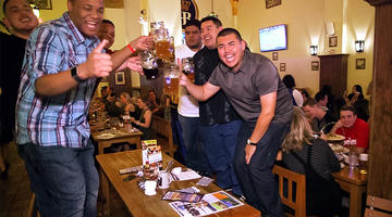 Guests enjoying the experience of standing on the benches at Hofbrauhaus Las Vegas